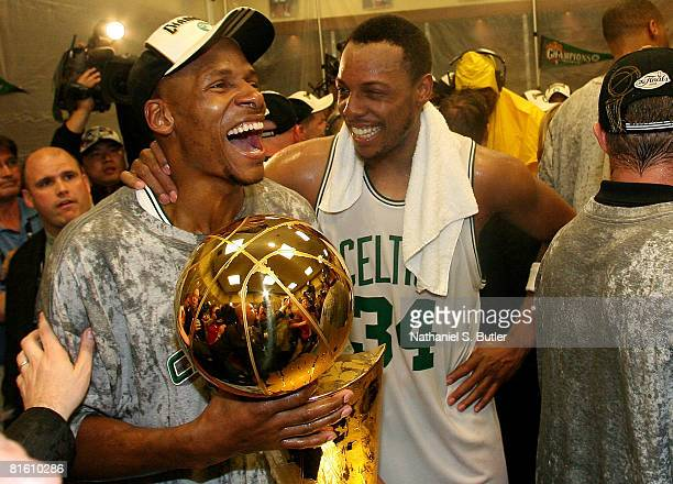 Ray Allen and Paul Pierce of the Boston Celtics celebrate with the Larry O'Brien championship trophy after defeating the Los Angeles Lakers in Game...