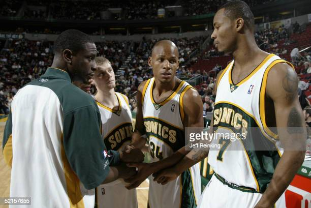 Ray Allen and Rashard Lewis of the Seattle Sonics huddle with their teammates Luke Ridnour and Ronald Murray during the game against the Utah Jazz on...