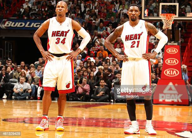 Ray Allen and Roger Mason Jr #21 of the Miami Heat look on against the New Orleans Pelicans at the American Airlines Arena in Miami Florida on Jan 7...