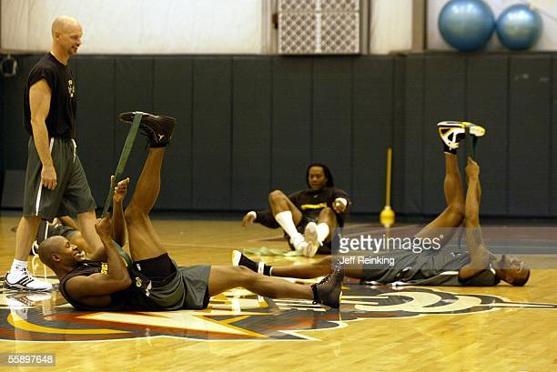 Ray Allen Danny Fortson and Rashard Lewis of the Seattle Supersonics stretch before practice at the Furtado Center on October 11 2005 in Seattle...