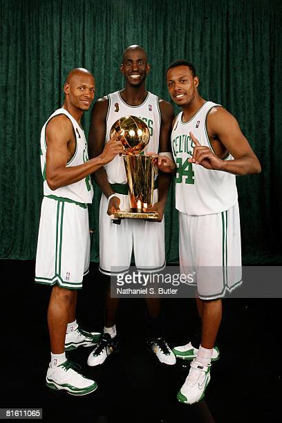 Ray Allen Kevin Garnett and Paul Pierce of the Boston Celtics poses for a portrait with the Larry O'Brien trophy after defeating the Los Angeles...