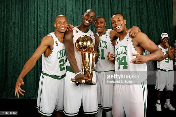 Ray Allen, Kevin Garnett, James Posey and Paul Pierce of the Boston Celtics pose for a portrait with the Larry O'Brien trophy after defeating the Los...