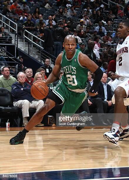 Ray Allen of the Boston Celtics drives against Joe Johnson of the Atlanta Hawks at Philips Arena on December 17 2008 in Atlanta Georgia NOTE TO USER...