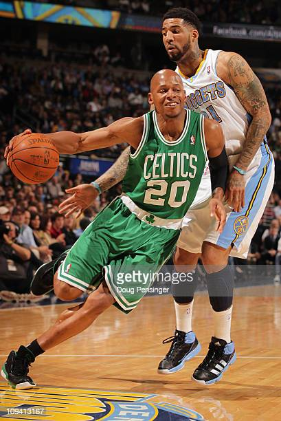 Ray Allen of the Boston Celtics drives around Wilson Chandler of the Denver Nuggets during NBA action at the Pepsi Center on February 24 2011 in...