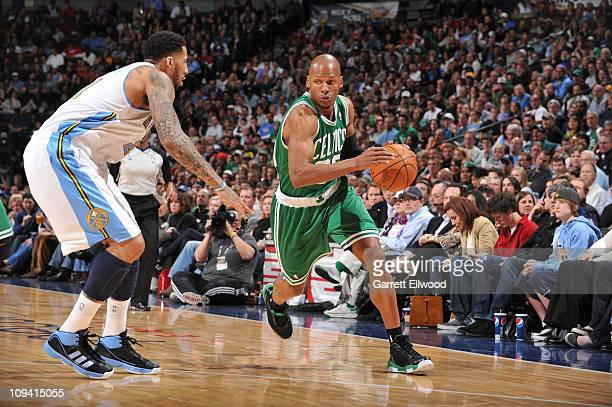 Ray Allen of the Boston Celtics drives to the basket against Wilson Chandler of the Denver Nuggets on February 24 2011 at the Pepsi Center in Denver...