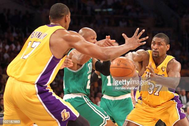 Ray Allen of the Boston Celtics looses the ball between Ron Artest and Andrew Bynum of the Los Angeles Lakers in the first quarter of Game Seven of...