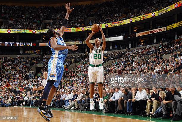 Ray Allen of the Boston Celtics shoots a jump shot over Nene of the Denver Nuggets at the TD Banknorth Garden on November 7 2007 in Boston...