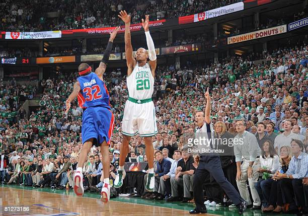 Ray Allen of the Boston Celtics shoots a three pointer against Richard Hamilton of the Detroit Pistons during Game Five of the Eastern Conference...