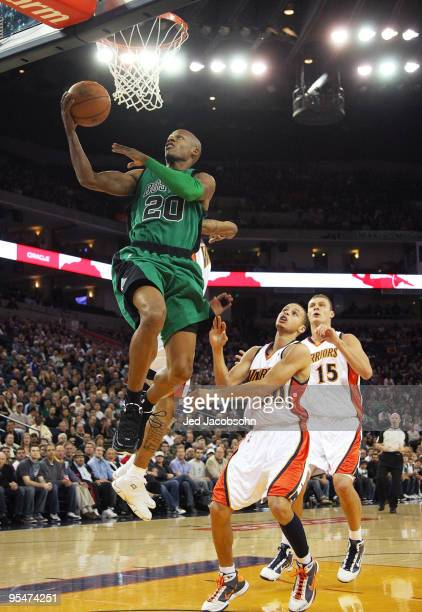 Ray Allen of the Boston Celtics shoots over Stephen Curry of the Golden State Warriors during an NBA game at Oracle Arena on December 28 2009 in...