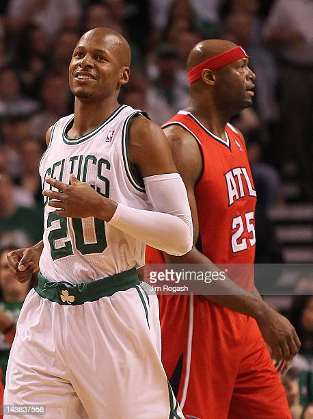 Ray Allen of the Boston Celtics smiles as he walks by Erick Dampier of the Atlanta Hawks in Game Three of the Eastern Conference Quarterfinals during...