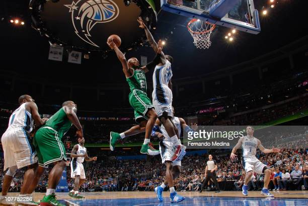 Ray Allen of the Boston Celtics takes the ball to the basket against Brandon Bass of the Orlando Magic on December 25 2010 at the Amway Center in...