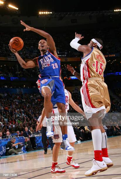 Ray Allen of the Eastern Conference drives for a shot attempt against Carmelo Anthony of the Western Conference during the 2008 NBA AllStar Game part...