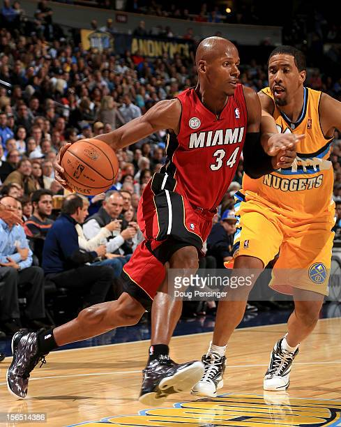Ray Allen of the Miami Heat controls the ball against Andre Miller of the Denver Nuggets at the Pepsi Center on November 15 2012 in Denver Colorado...