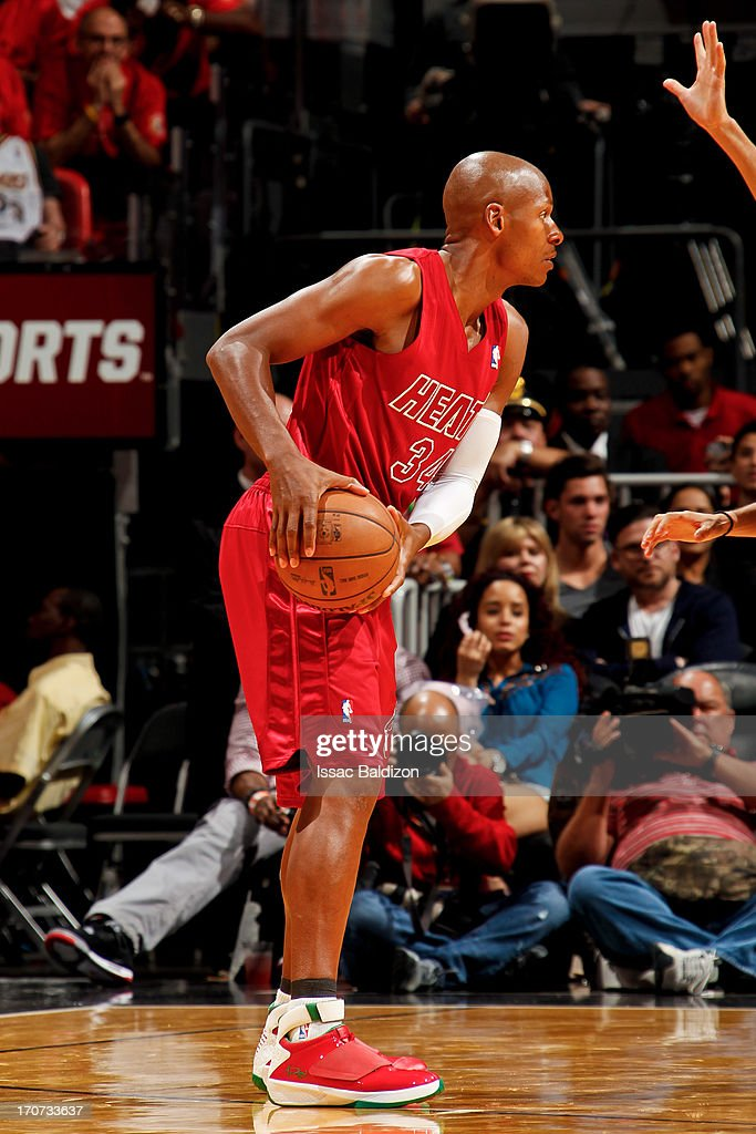 Ray Allen #34 of the Miami Heat controls the ball against the Oklahoma City Thunder during a Christmas Day game on December 25, 2012 at American Airlines Arena in Miami, Florida.