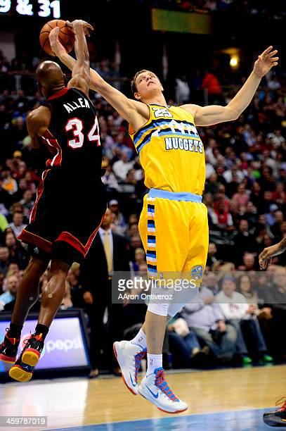 Ray Allen of the Miami Heat defends Timofey Mozgov of the Denver Nuggets during the first half of action The Denver Nuggets hosted the Miamia Heat at...
