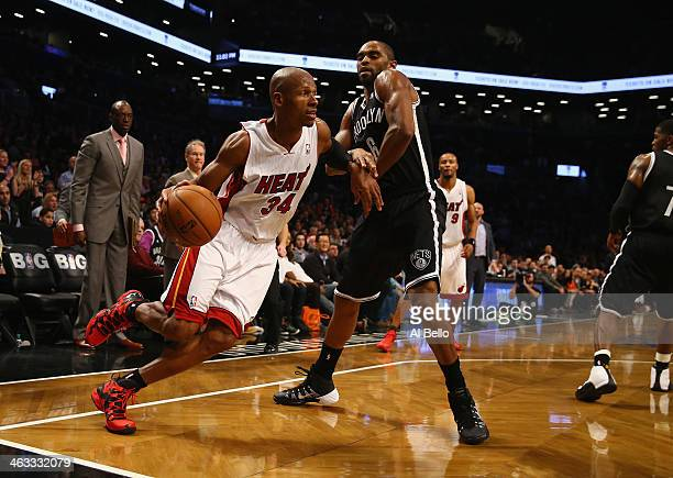 Ray Allen of the Miami Heat drives against Alan Anderson of the Brooklyn Nets during their game at the Barclays Center on January 10 2014 in New York...