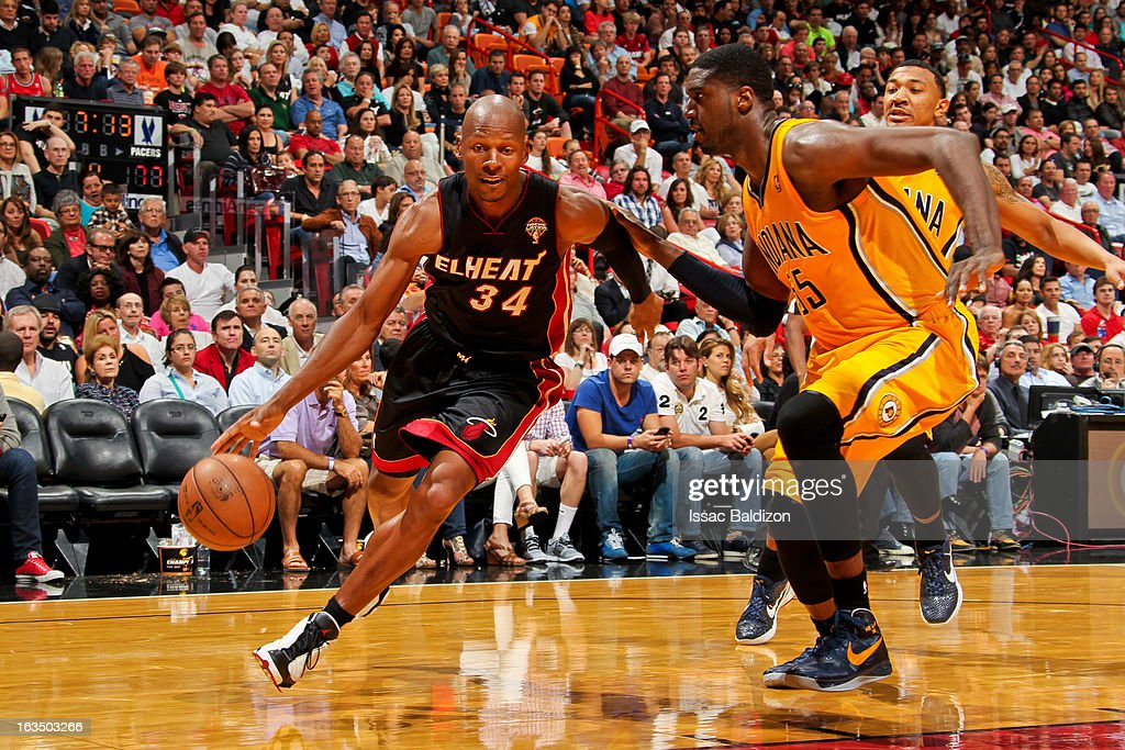 Ray Allen #34 of the Miami Heat drives against Roy Hibbert #55 of the Indiana Pacers on March 10, 2013 at American Airlines Arena in Miami, Florida.
