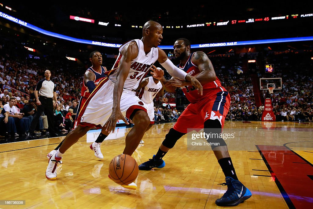Ray Allen #34 of the Miami Heat drives against Trevor Booker #35 of the Washington Wizards at American Airlines Arena on November 3, 2013 in Miami, Florida.