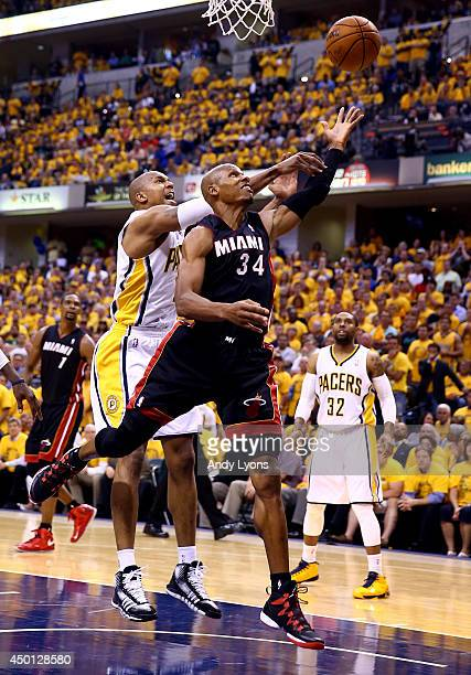 Ray Allen of the Miami Heat drives to the basket as David West of the Indiana Pacers defends during Game Five of the Eastern Conference Finals of the...