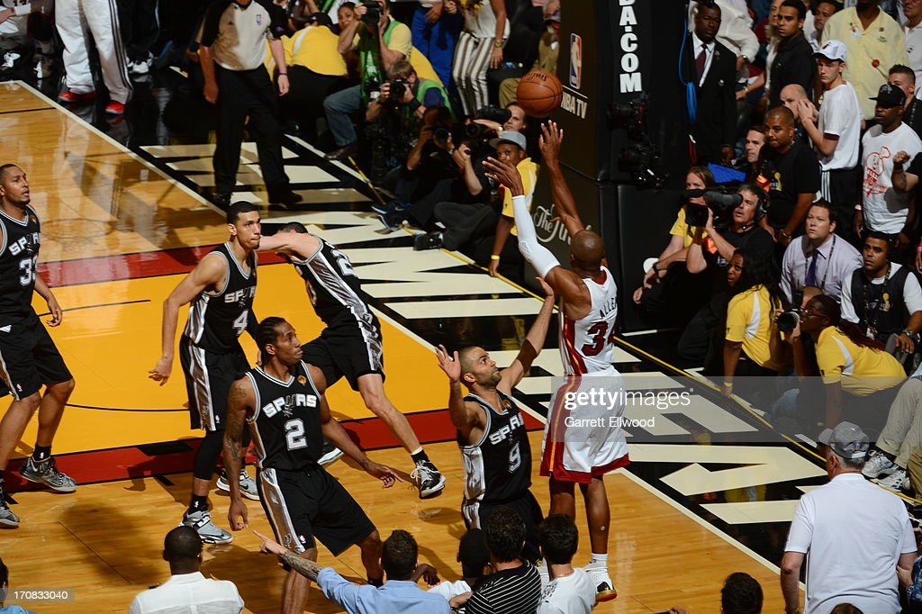 Ray Allen #34 of the Miami Heat hits the game tying three pointer against Tony Parker #9 of the San Antonio Spurs during Game Six of the 2013 NBA Finals on June 18, 2013 at American Airlines Arena in Miami, Florida.