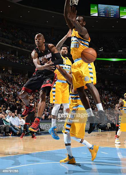 Ray Allen of the Miami Heat passes the ball in midair against the Denver Nuggets on December 30 2013 at the Pepsi Center in Denver Colorado NOTE TO...