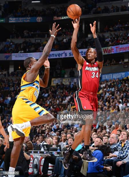 Ray Allen of the Miami Heat shoots against Jordan Hamilton of the Denver Nuggets on November 15 2012 at the Pepsi Center in Denver Colorado NOTE TO...
