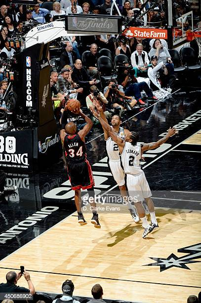 Ray Allen of the Miami Heat shoots against Kawhi Leonard and Tim Duncan of the San Antonio Spurs in Game Five of the 2014 NBA Finals on June 15 2014...