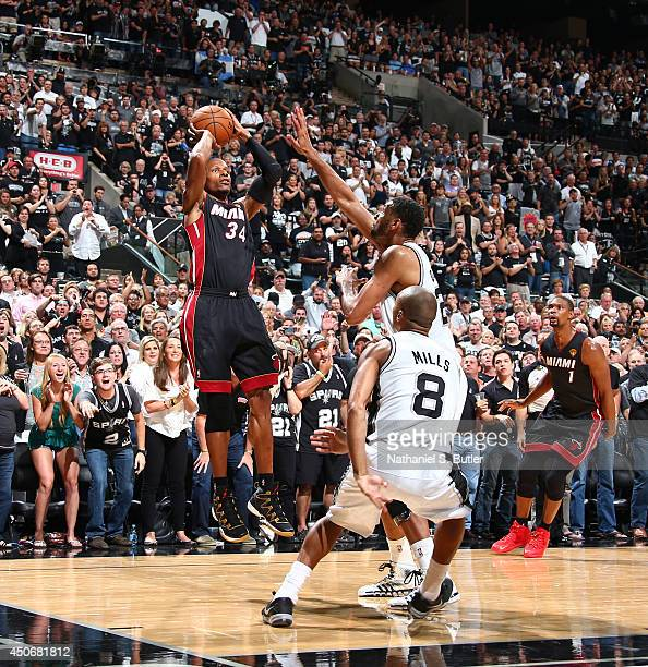 Ray Allen of the Miami Heat shoots against Tim Duncan of the San Antonio Spurs during Game Five of the 2014 NBA Finals at ATT Center on June 15 2014...