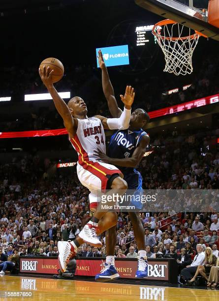 Ray Allen of the Miami Heat shoots over Darren Collison of the Dallas Mavericks during a game at American Airlines Arena on January 2 2013 in Miami...