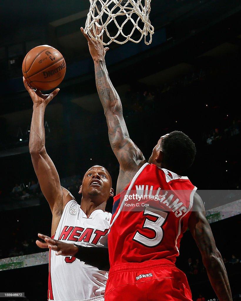 Ray Allen #34 of the Miami Heat shoots over Louis Williams #3 of the Atlanta Hawks at Philips Arena on November 9, 2012 in Atlanta, Georgia.