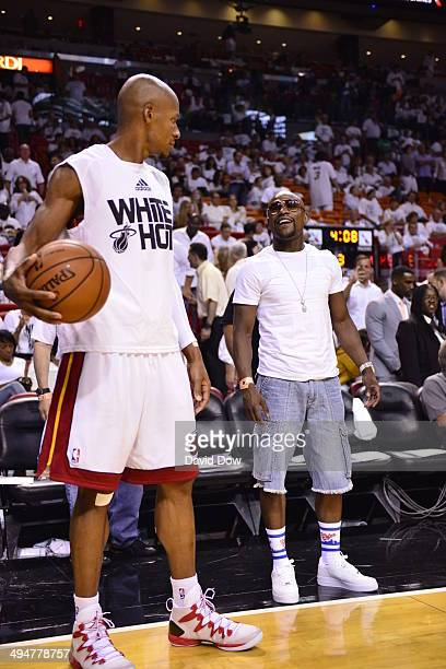 Ray Allen of the Miami Heat speaks to boxer Floyd Mayweather before the game against the Indiana Pacers in Game Six of the Eastern Conference Finals...