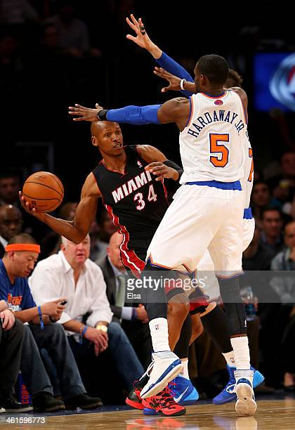 Ray Allen of the Miami Heat tries to pass as Tim Hardaway Jr #5 and Andrea Bargnani of the New York Knicks defend at Madison Square Garden on January...