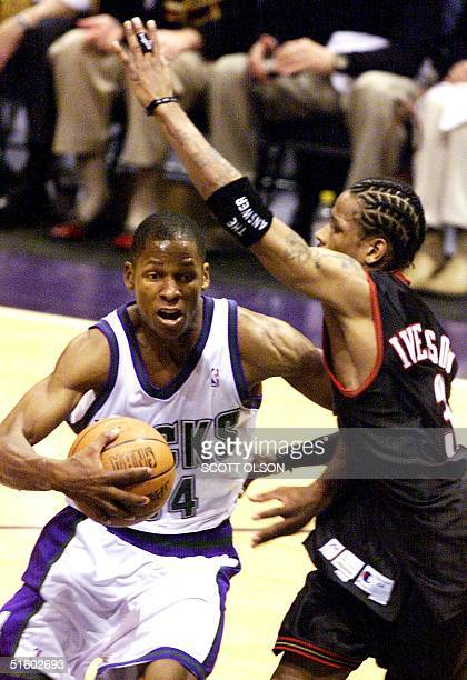 Ray Allen of the Milwaukee Bucks drives around Allen Iverson of the Philadelphia 76ers in the NBA Eastern Conference final game six 01 June at the...