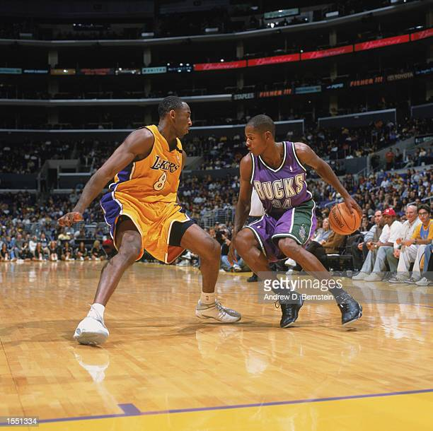 Ray Allen of the Milwaukee Bucks drives the ball around defender Kobe Bryant of the Los Angeles Lakers during the NBA preseason game on October 24...