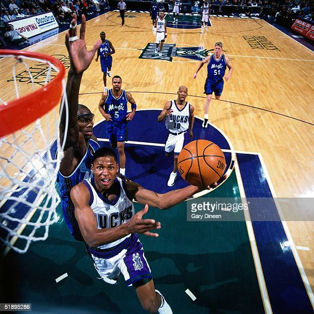 Ray Allen of the Milwaukee Bucks drives to the basket for a layup against the Orlando Magic during the NBA game in Milwaukee Wisconsin in 2000 NOTE...