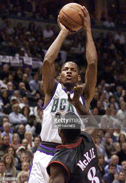 Ray Allen of the Milwaukee Bucks gets off a shot over Aaron McKie of the Philadelphia 76ers during game six of their NBA Eastern Conference finals 01...