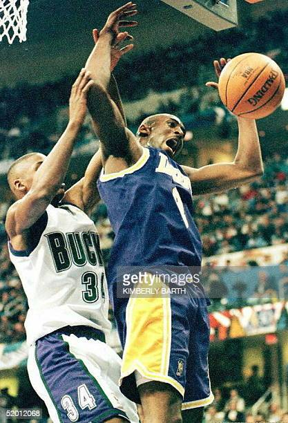 Ray Allen of the Milwaukee Bucks knocks the ball lose from Kobe Bryant of the Los Angeles Lakers 08 February during the first half of the NBA AllStar...