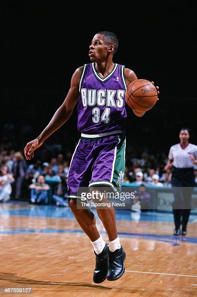 Ray Allen of the Milwaukee Bucks moves the ball during the game against the Charlotte Hornets on December 29 1999 at Charlotte Coliseum in Charlotte...