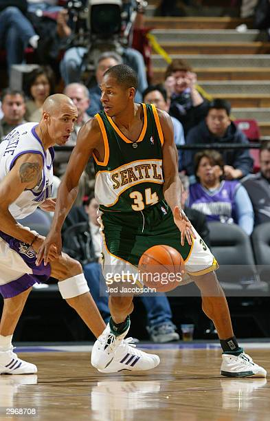 Ray Allen of the Seattle Sonics is defended by Doug Christie of the Sacramento Kings during the game at Arco Arena on February 3 2004 in Sacramento...