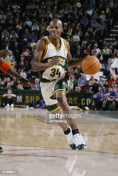 Ray Allen of the Seattle Sonics moves the ball during the game against the Phoenix Suns at Key Arena on December 17 2004 in Seattle Washington The...