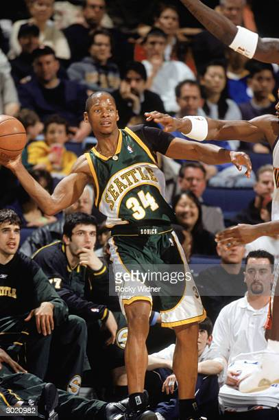 Ray Allen of the Seattle Sonics passes against the Golden State Warriors during the game on February 21 2004 at the Arena in Oakland California The...