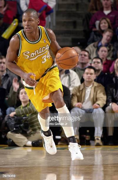 Ray Allen of the Seattle Sonics talks moves the ball up court during the game against the Dallas Mavericks on January 27, 2004 at Key Arena in...