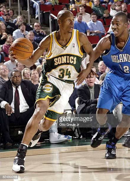 Ray Allen of the Seattle SuperSonics drives against Dwight Howard of the Orlando Magic on March 18 2005 at Key Arena in Seattle Washington The Sonics...