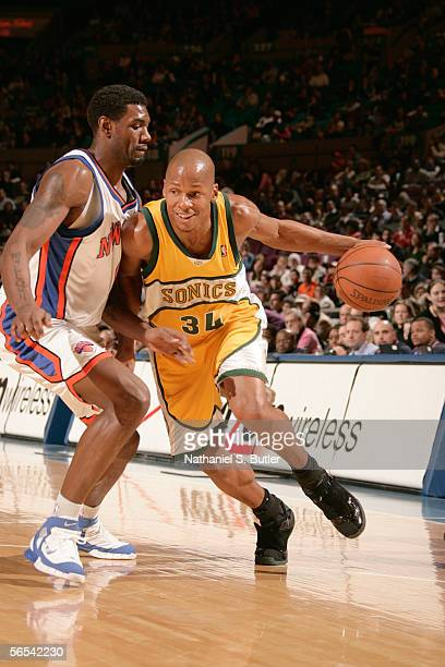 Ray Allen of the Seattle SuperSonics drives against Qyntel Woods of the New York Knicks at Madison Square Garden on January 8 2006 in New York City...
