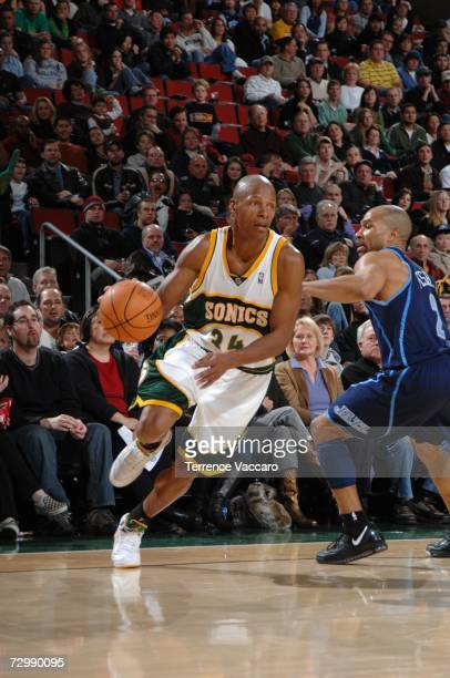 Ray Allen of the Seattle SuperSonics drives pass the defense of Derek Fisher of the Utah Jazz on January 12 2007 at the Key Arena in Seattle...