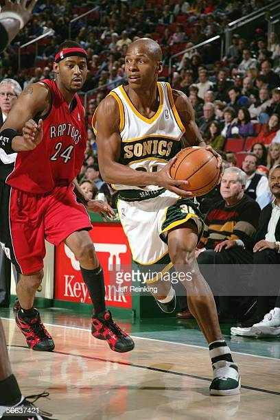 Ray Allen of the Seattle SuperSonics drives past Morris Peterson of the Toronto Raptors at Key Arena on January 20, 2006 in Seattle, Washington. NOTE...