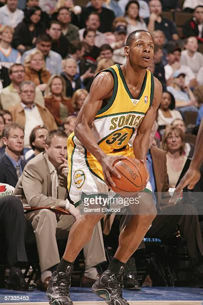 Ray Allen of the Seattle SuperSonics looks to move the ball against the Denver Nuggets on March 30 2006 at the Pepsi Center in Denver Colorado The...