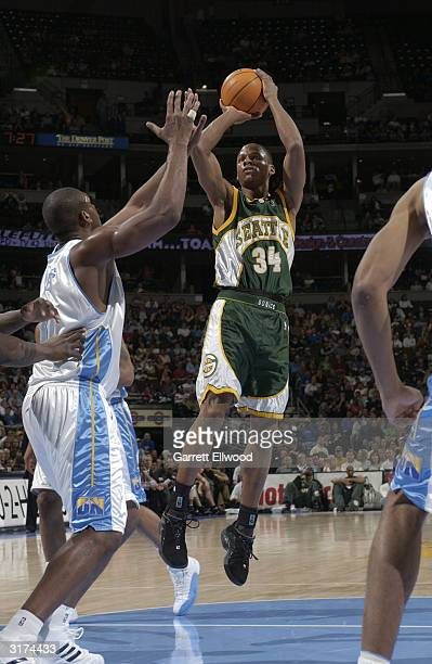 Ray Allen of the Seattle SuperSonics shoots against the Denver Nuggets March 30 2004 at the Pepsi Center in Denver Colorado NOTE TO USER User...