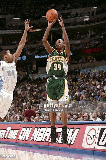 Ray Allen of the Seattle SuperSonics shoots over Andre Miller of the Denver Nuggets on December 29 2005 at the Pepsi Center in Denver Colorado NOTE...