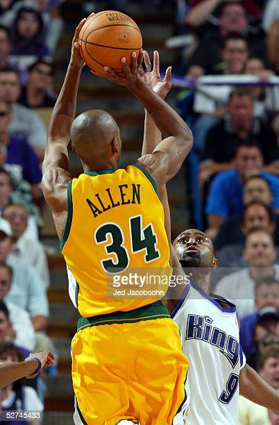 Ray Allen of the Seattle SuperSonics shoots over Kenny Thomas of the Sacramento Kings in Game four of the Western Conference during the 2005 NBA...